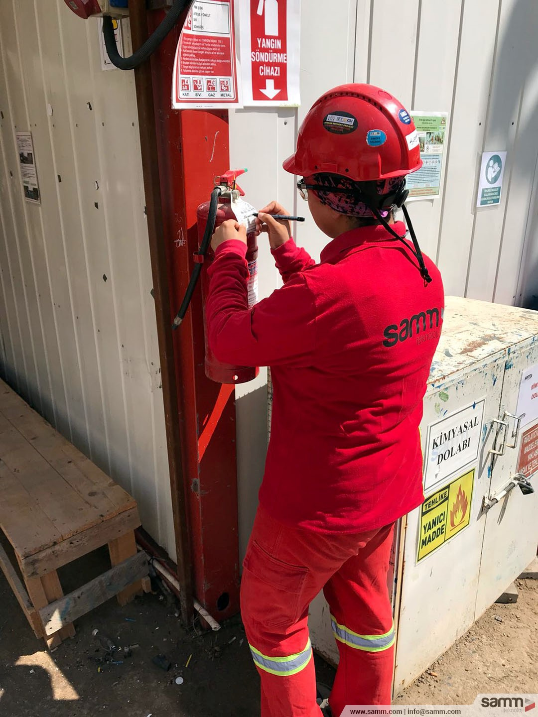 Samm Teknoloji | Fire extinguishers are being checked by HSE supervisor.