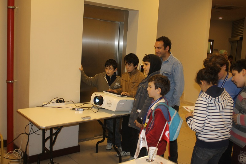 Authorities and kids playing Raspberry Pi